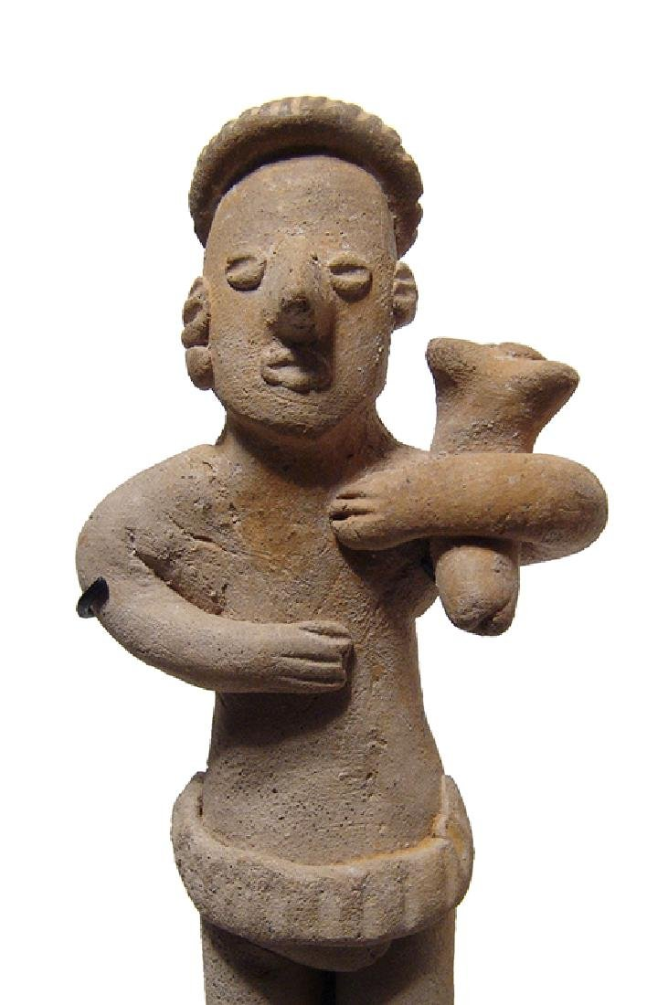 Charming Colima standing male figure holding puppy - 2