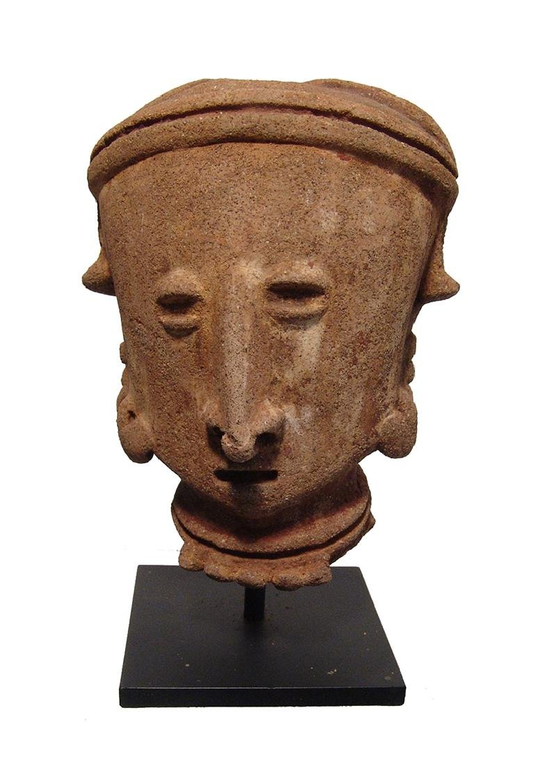 A Chinesco 'Type D' ceramic head from a large figure
