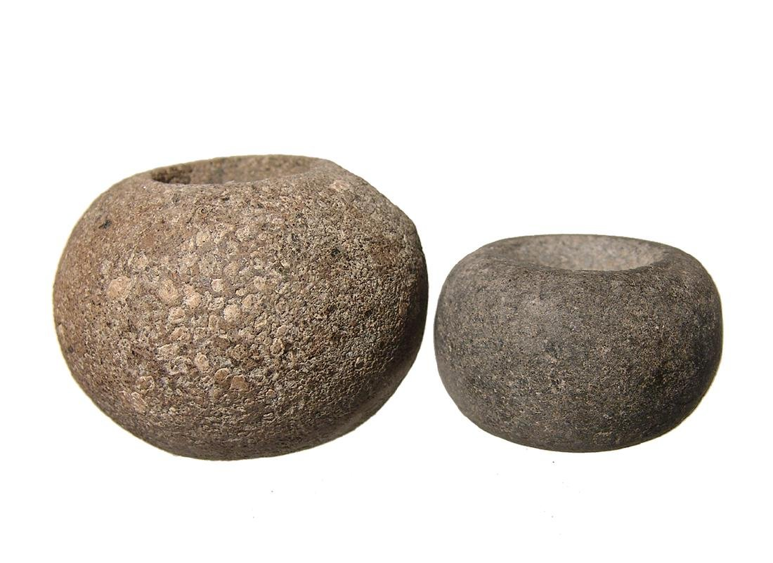 A pair of Nicoya stone mace heads, Costa Rica