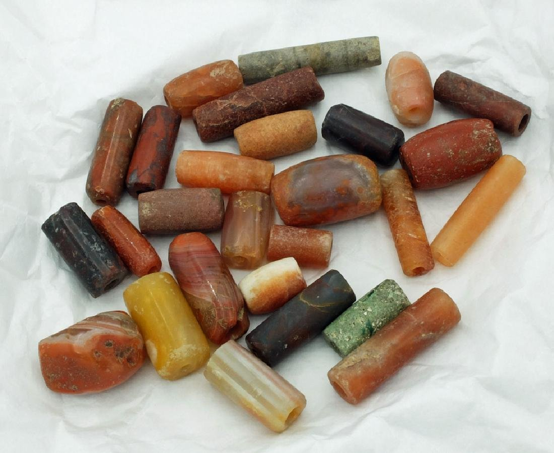 A collection of 27 Tairona stone beads from Colombia