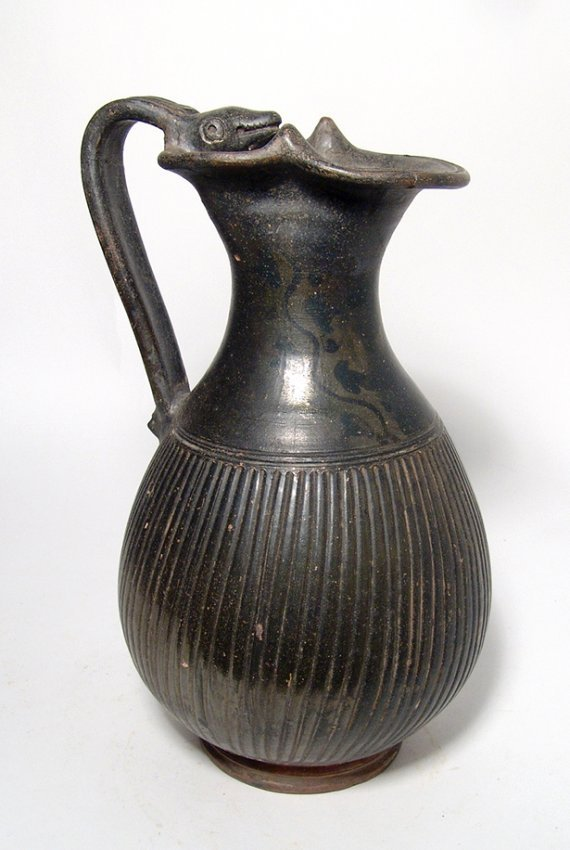 A lovely Apulian Greek ribbed olpe with animal handle