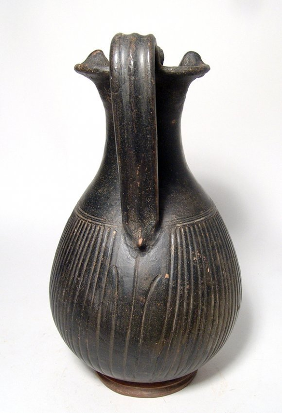 A lovely Apulian Greek ribbed olpe with animal handle - 4