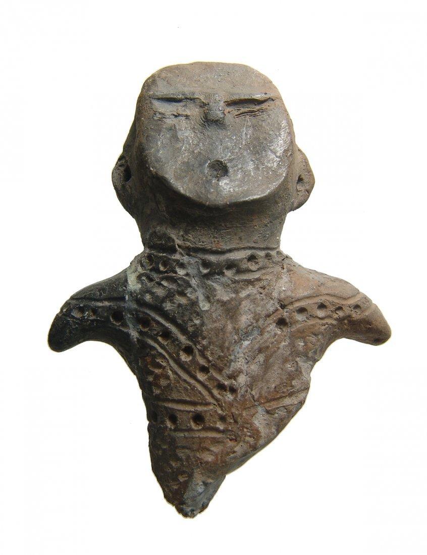 A Jomon ceramic effigy figure, Japan