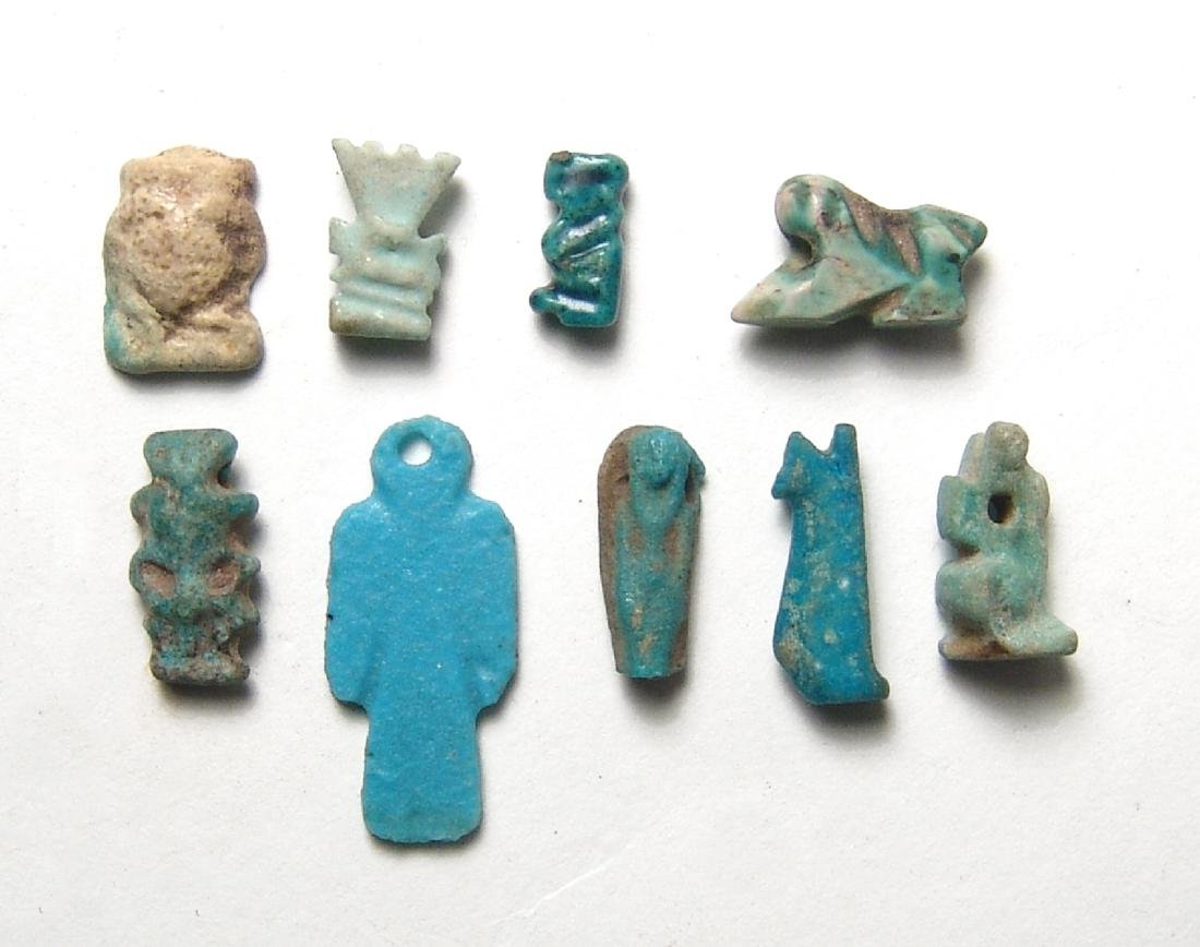 A group of 9 assorted Egyptian faience amulets