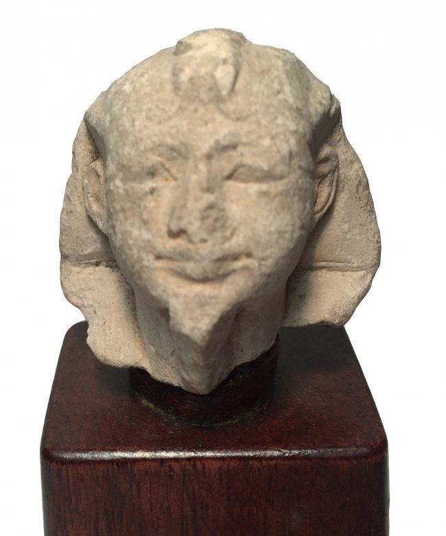 A rare and exquisite limestone portrait of a pharaoh