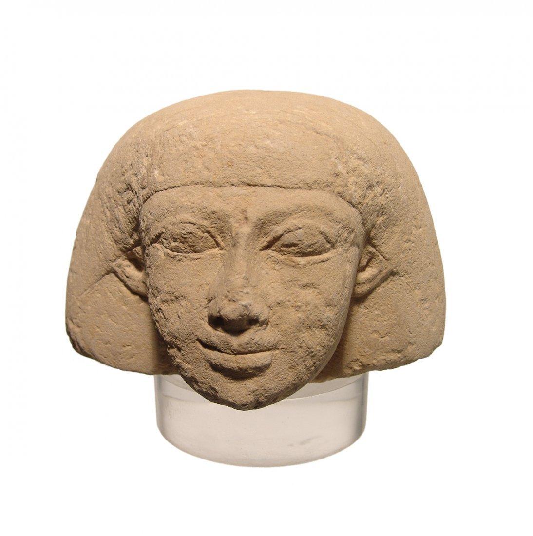 Egyptian sandstone Canopic jar lid representing Imsety