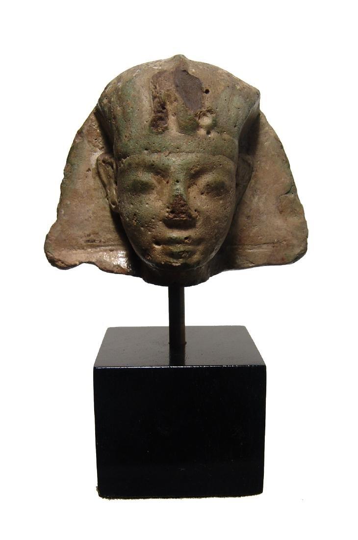 An Egyptian faience head of pharaoh, Ptolemaic