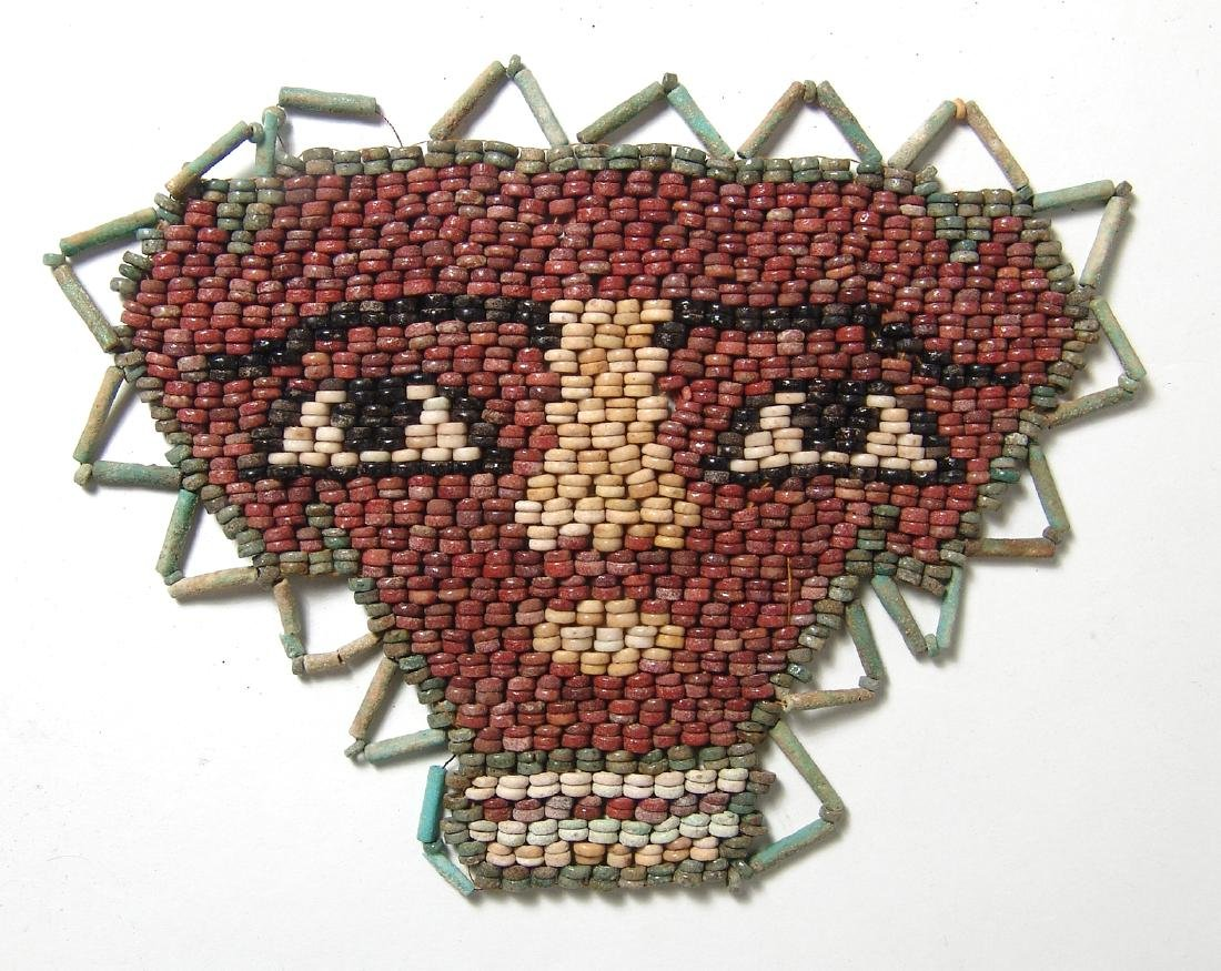 Beautiful Egyptian faience beads shaping a face mask