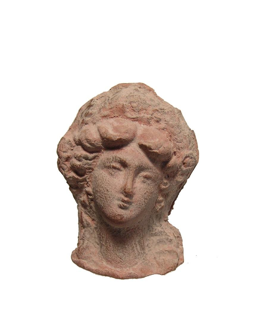 A beautiful Greek terracotta head of a woman