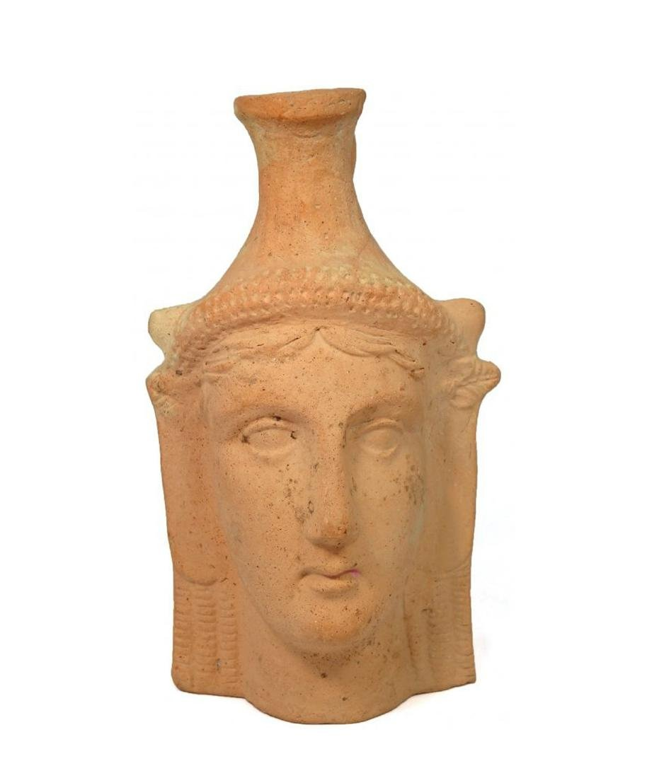 A Greek ceramic vessel depicting a female head