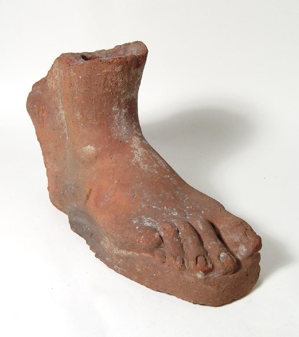 A highly detailed Etruscan terracotta votive right foot