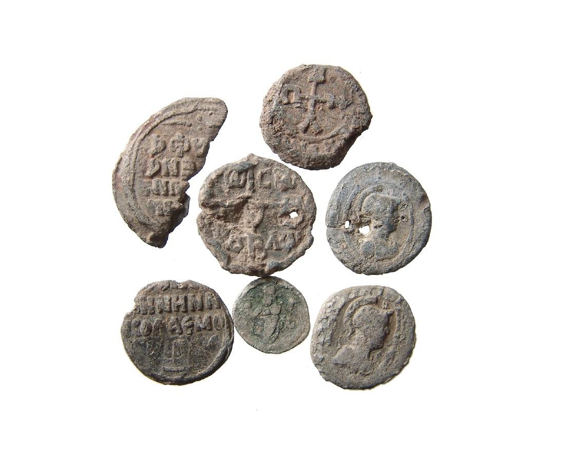 A lot of 7 Roman - Byzantine lead tokens or tesserae