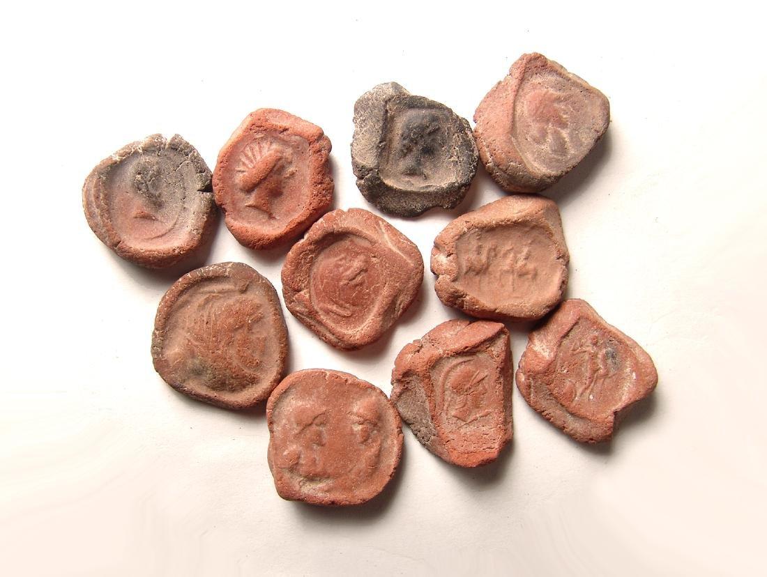 A group of 10 terracotta bullae