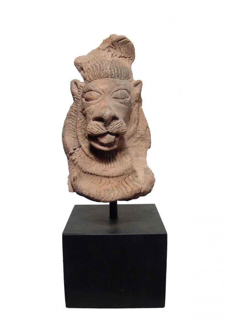 An East Indian terracotta head of a lion