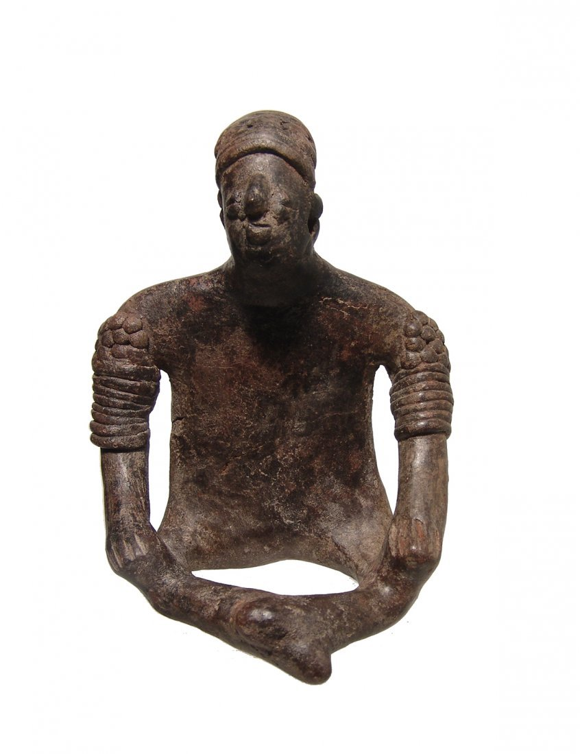 A handsome Colima seated solid black figure