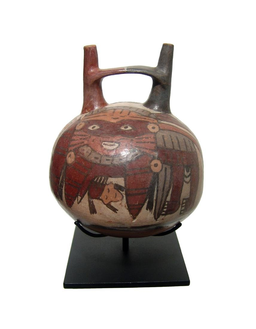 A beautiful Nazca polychromed stir-up vessel