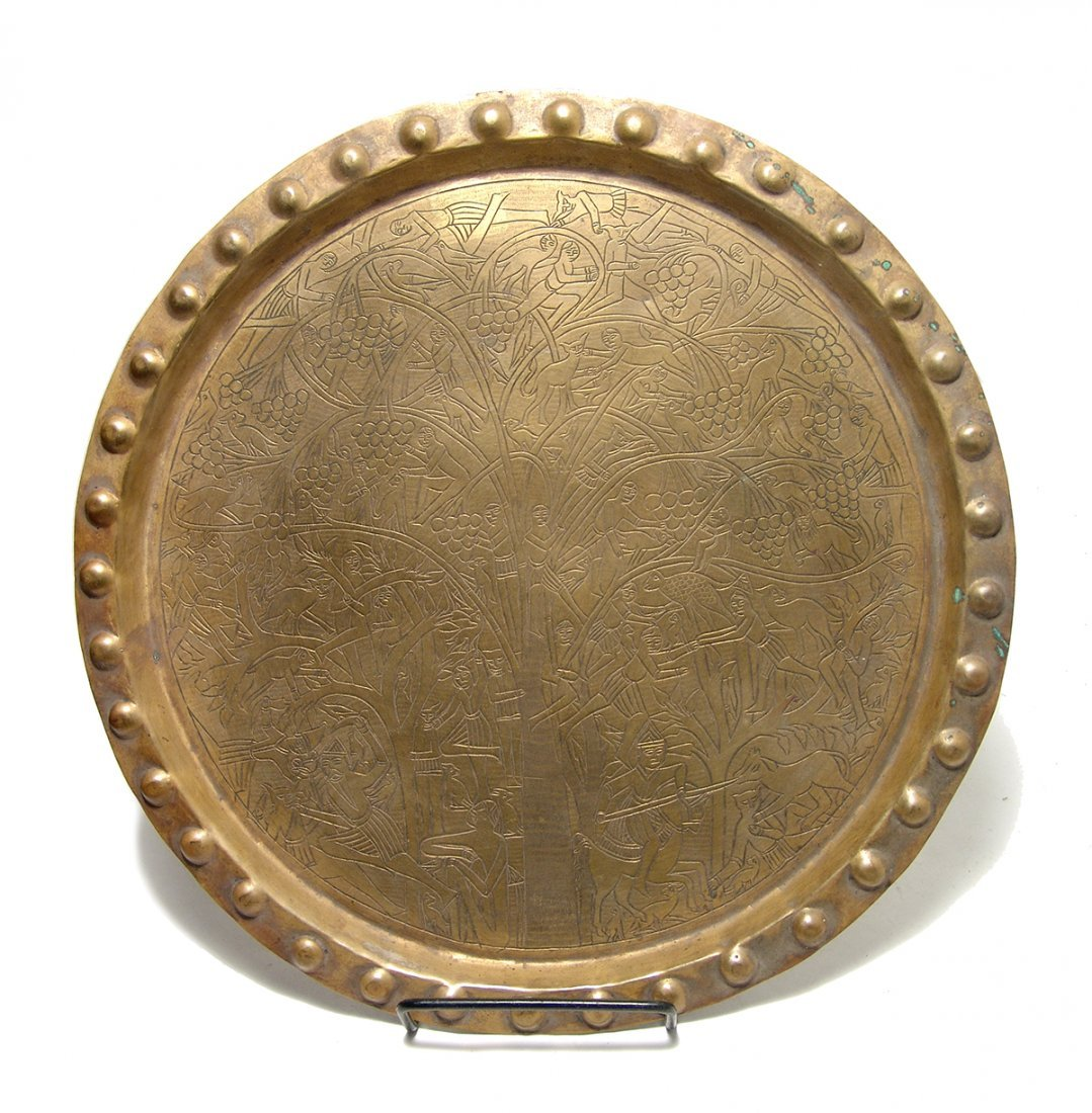 An attractive brass platter with ornate decoration