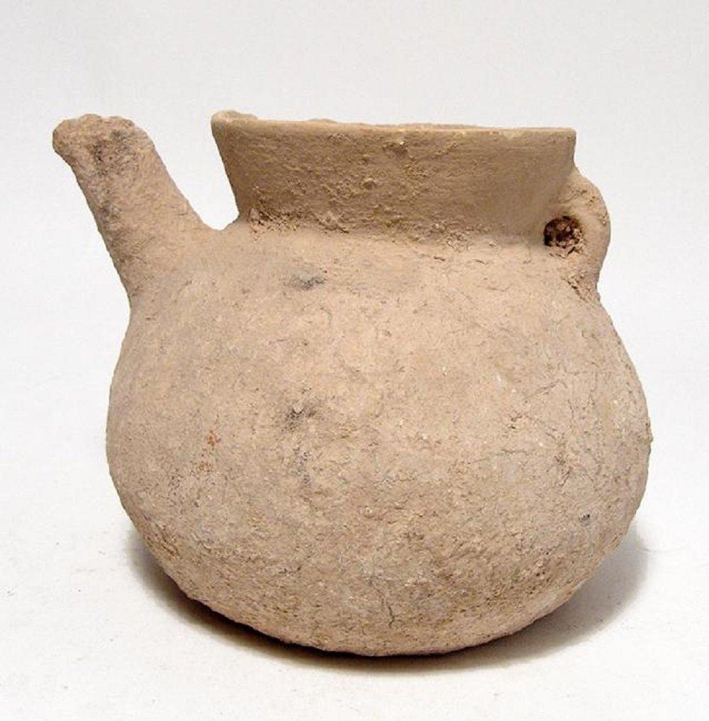A Bronze Age terracotta spouted jar