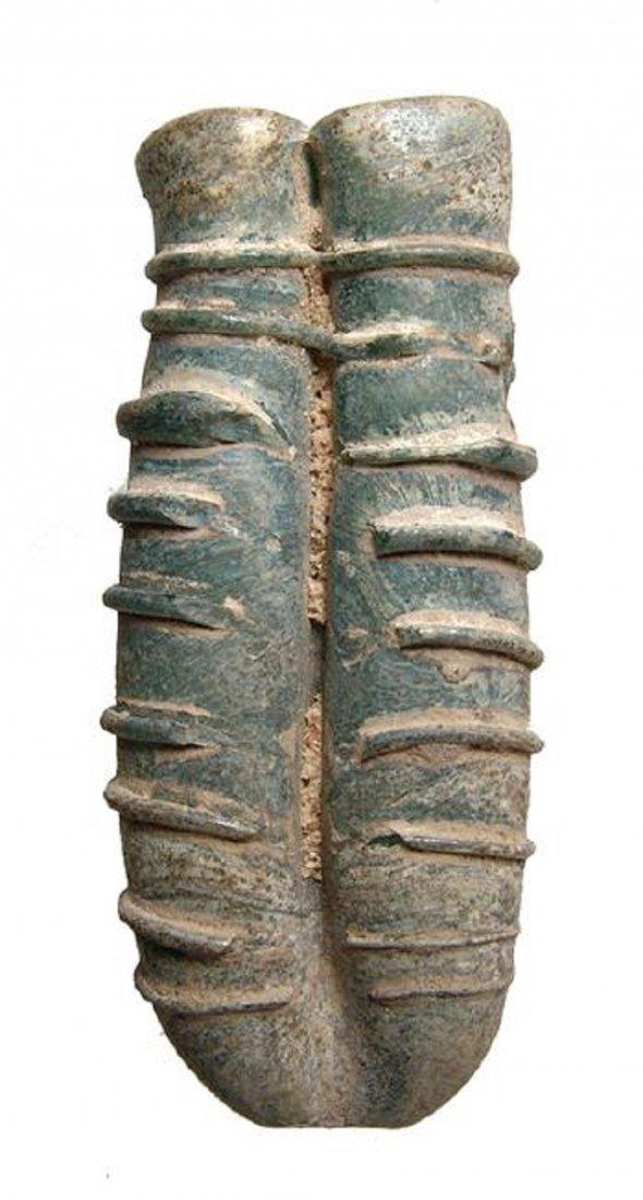 A Roman blue-green glass double unguentarium
