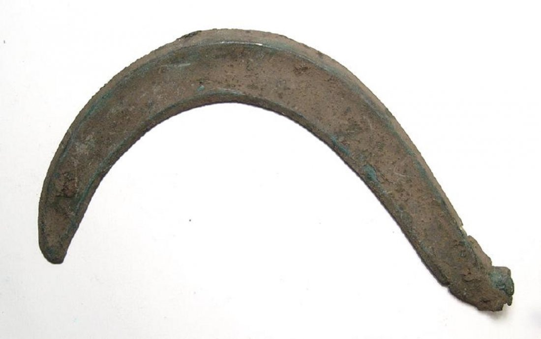 A Celtic bronze votive sickle, Hallstatt culture