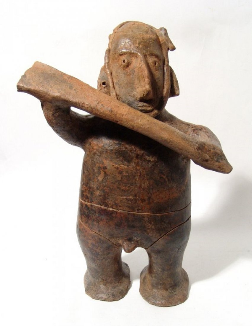 A large Colima standing warrior, West Mexico