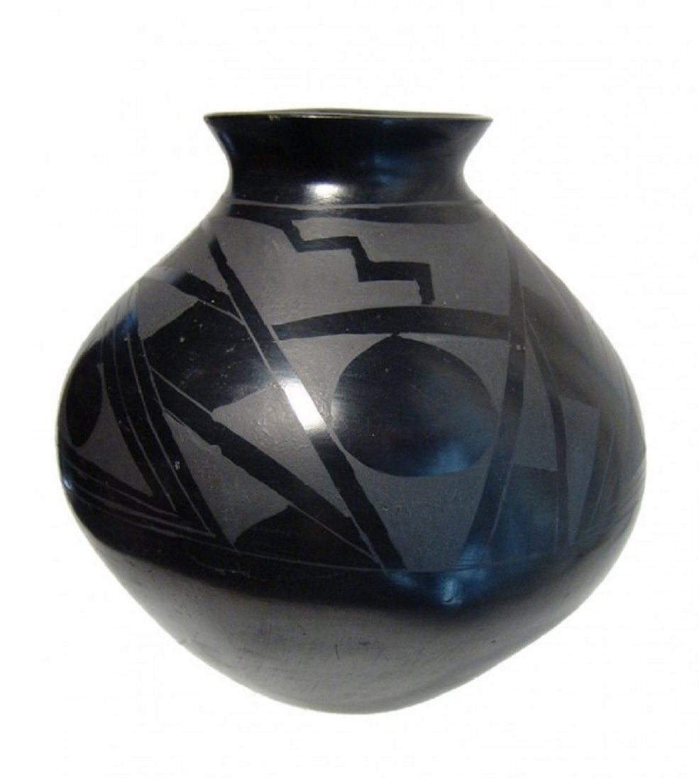 A lovely black on black olla by Dora Quezada
