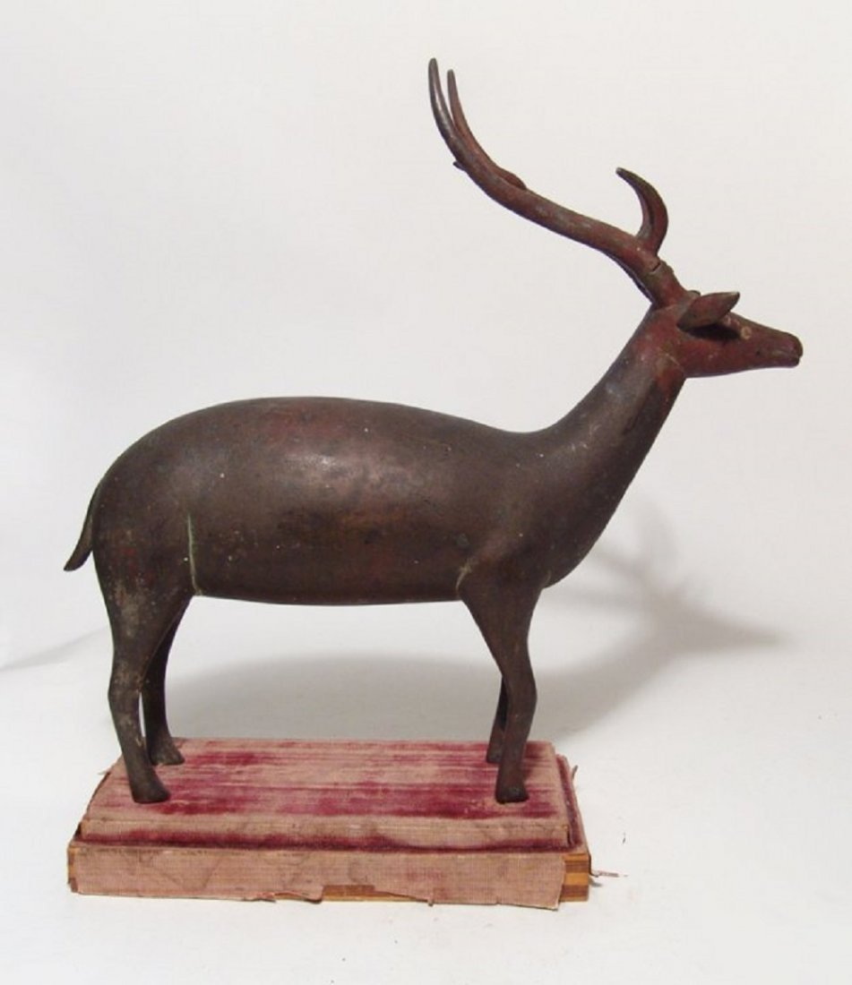 An wonderful antique bronze figure of a stag