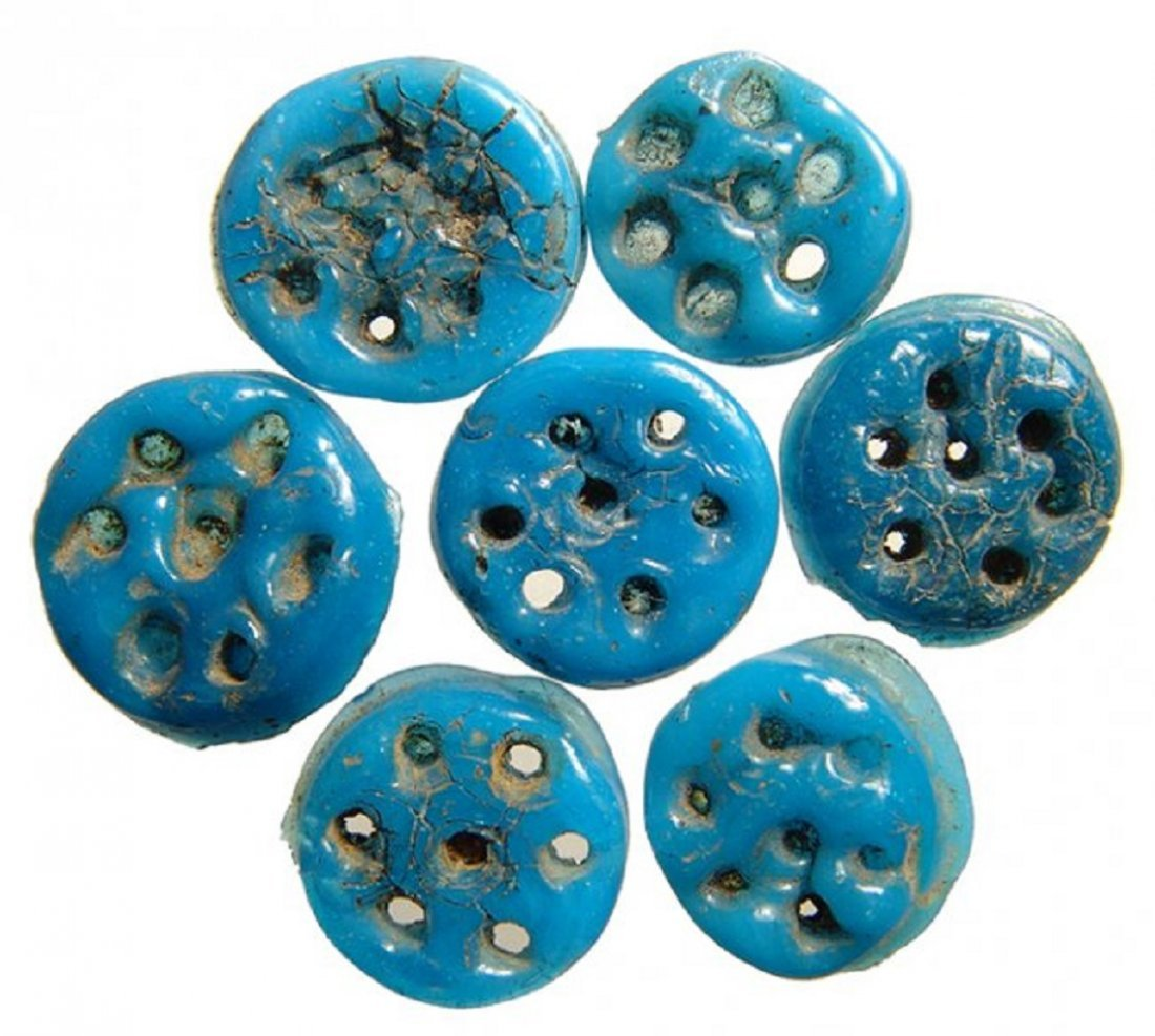 7 Egyptian blue faience rosettes, Ptolemaic Period