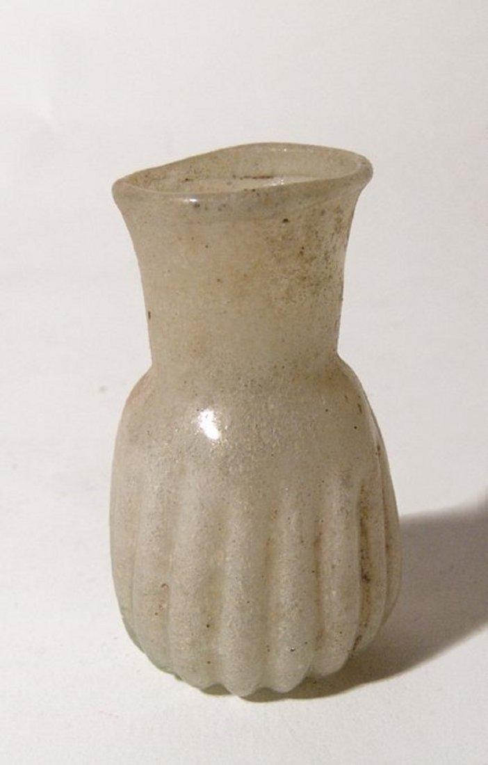 A Late Roman/Byzantine pale yellow glass bottle