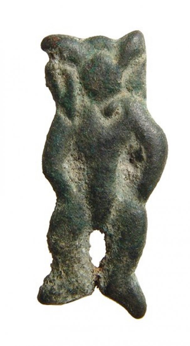 A Levantine bronze amulet of a standing deity