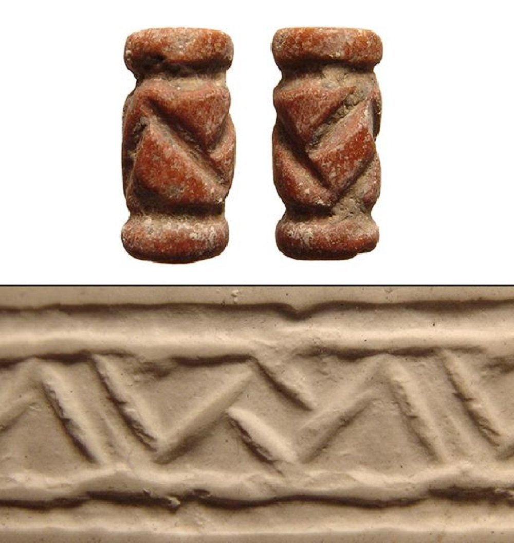 A Proto-Elamite red marble cylinder seal
