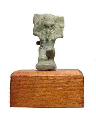 An Egyptian faience amulet of the sky god Shu
