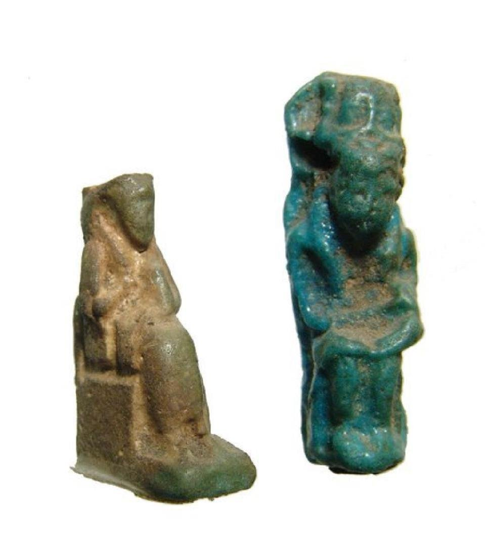 A pair of Egyptian faience amulets of Isis and Horus