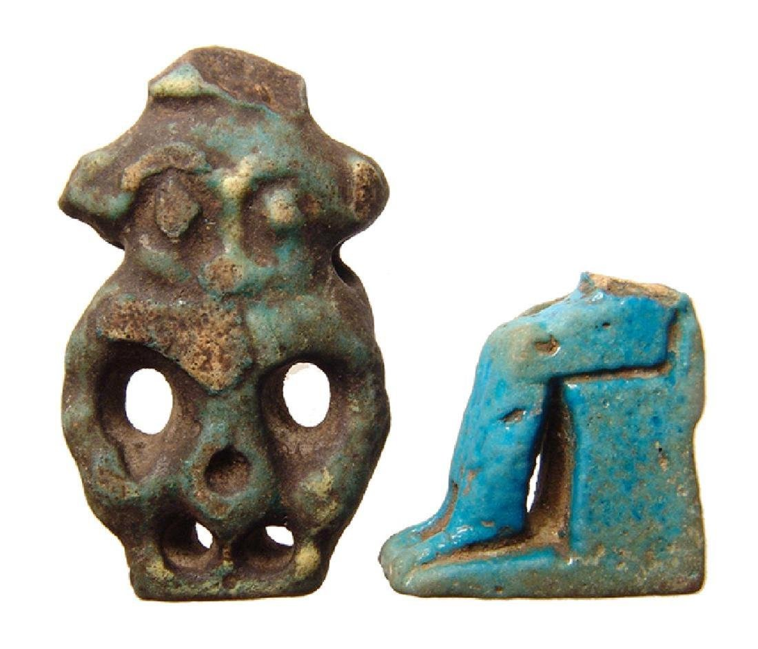 A pair of Egyptian faience amulets