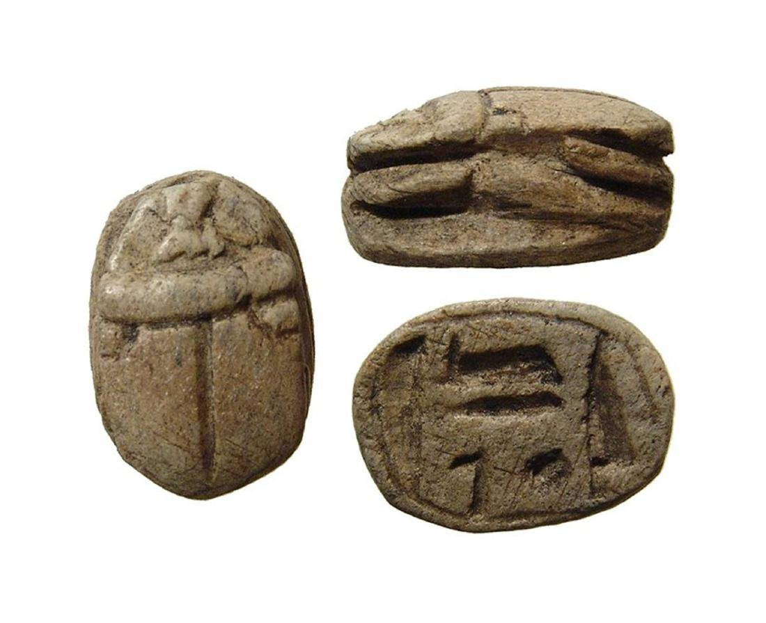 An Egyptian steatite scarab with Amen-Re inscription