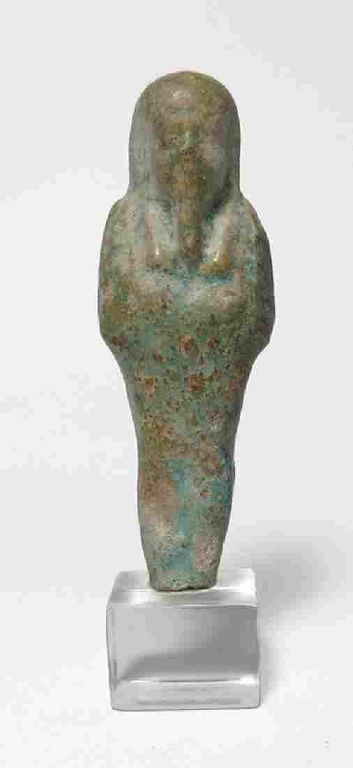 An Egyptian faience ushabti, Late Period