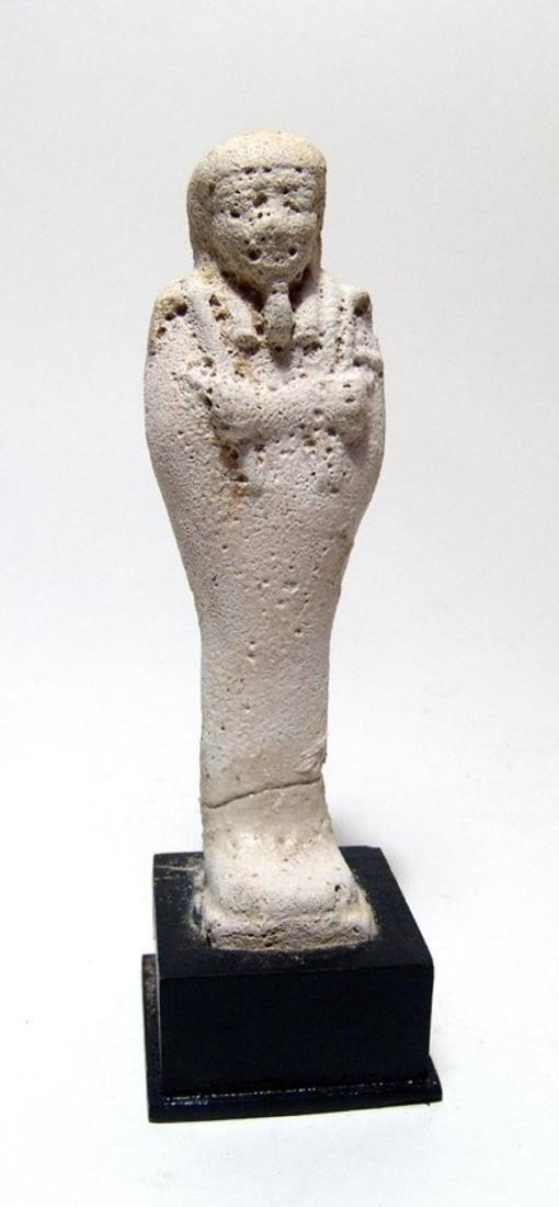 An Egyptian unglazed faience ushabti, Late Period
