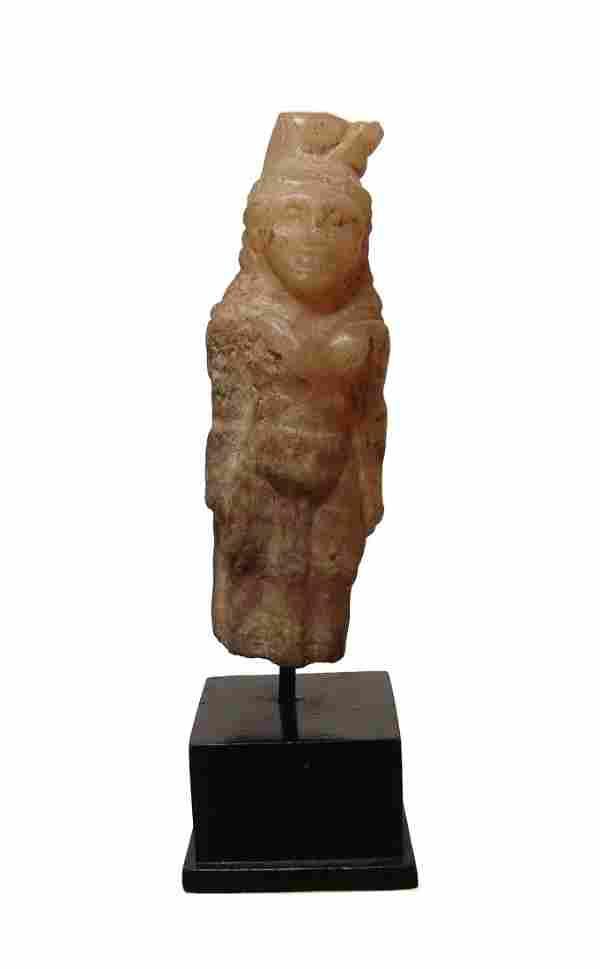An Egyptian alabaster figure of the goddess Hathor
