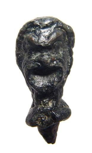 Roman bronze head of an actor with nice detail