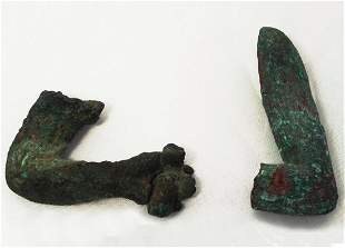 A pair of ancient bronze arm fragments