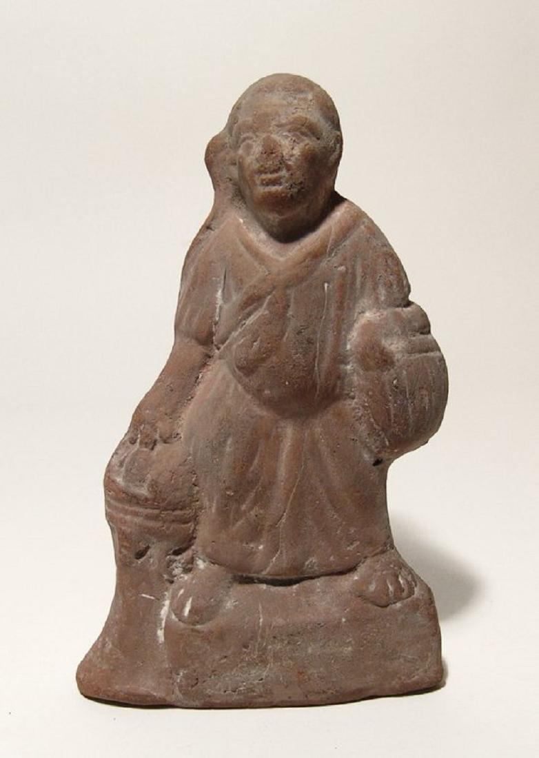 A Roman terracotta figure of Harpokrates, Egypt
