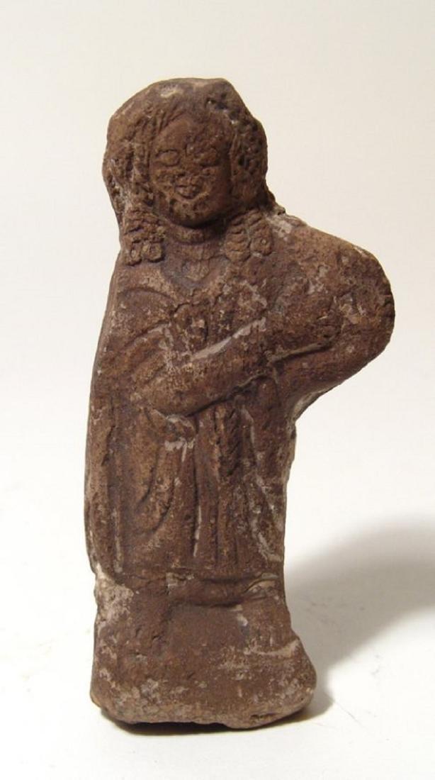 Roman terracotta figure of a robed woman, Egypt