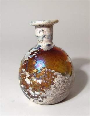 A gorgeous Roman amber glass bottle