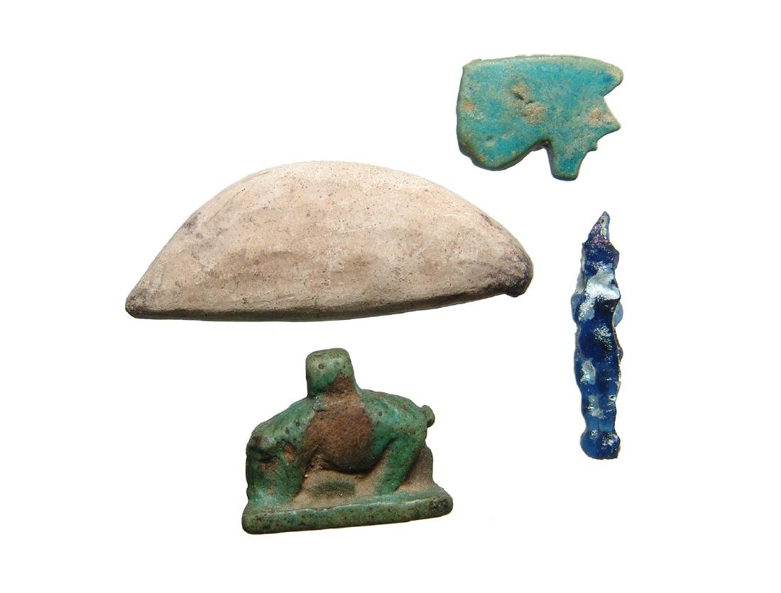 A group of Egyptian amulets and an Eye inlay - 2