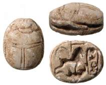 Egyptian scarab depicting a Sphinx trampling enemy