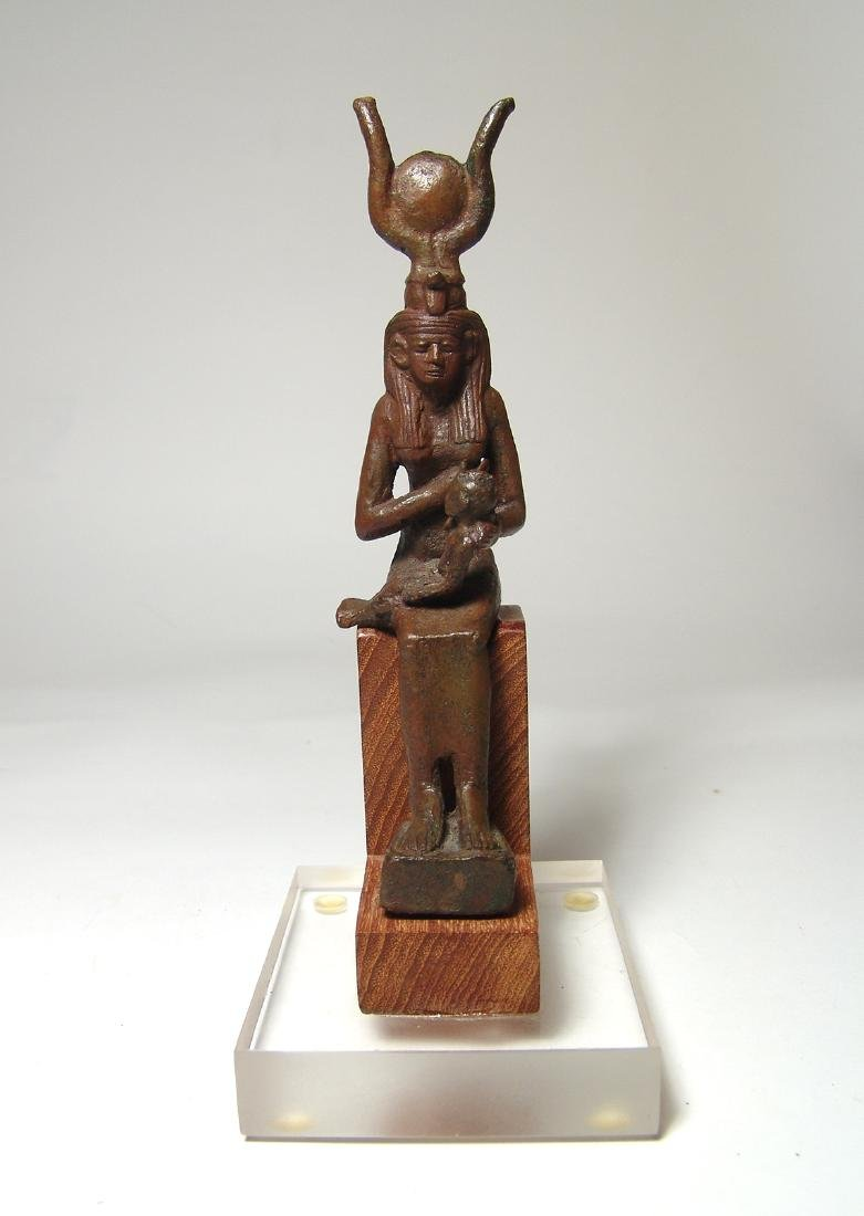 A fantastic Egyptian bronze figure of seated Isis