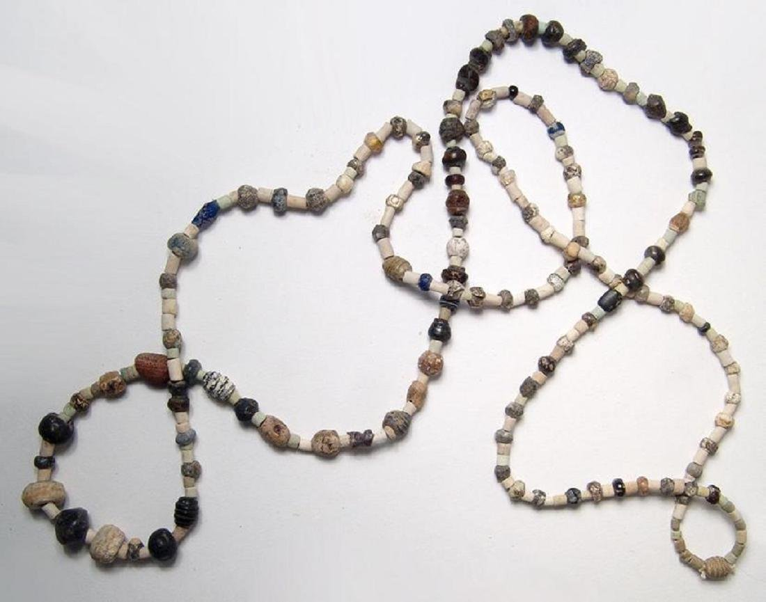 Strand of mixed ancient stone, glass, and faience beads