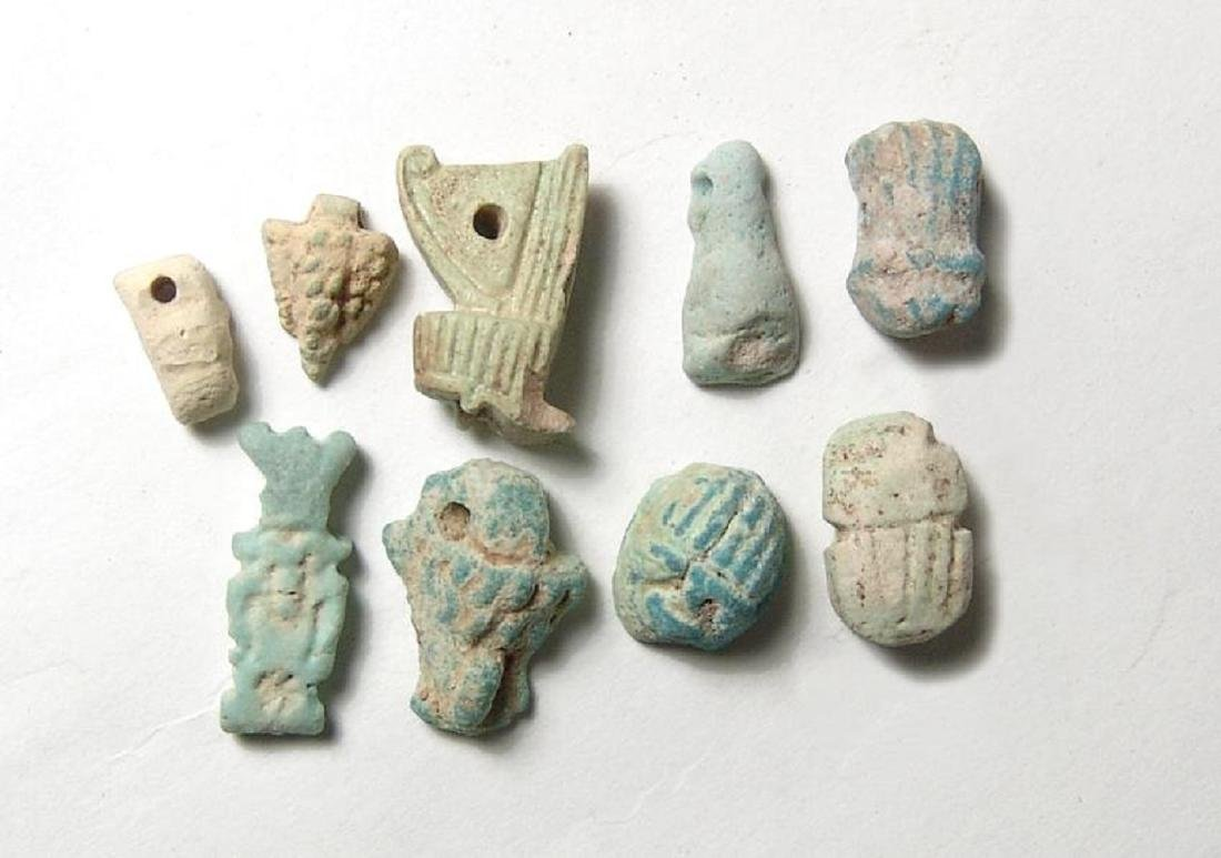 A nice group of 9 assorted Egyptian faience amulets