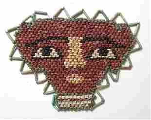 An attractive Egyptian faience beaded face mask