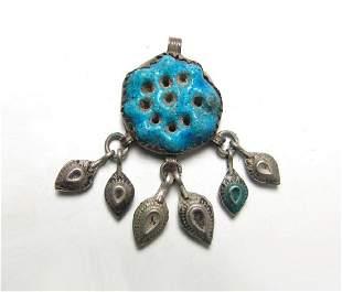 Egyptian blue-glazed rosette amulet set into a brooch